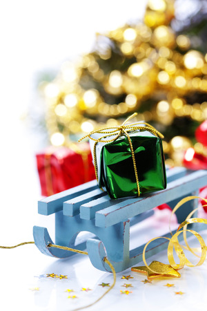 Bright christmas composition with sledge photo