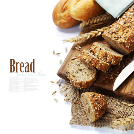 Freshly baked  bread on white background. With easy removable sample text photo