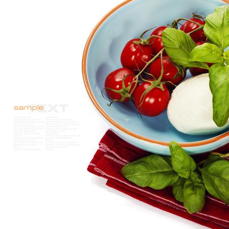 caprese salad: Caprese - Italian salad with tomatos, basil, and mozarella cheese over white