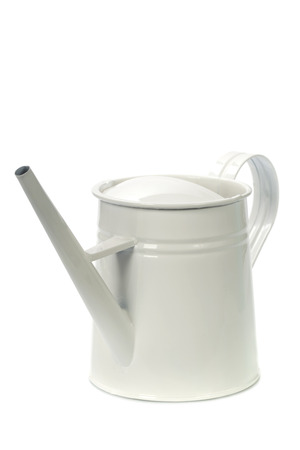 Watering can over white photo