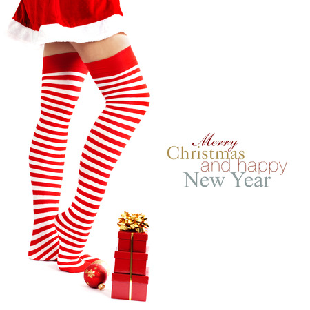 Woman wearing santa little helper costume. With easy removable sample text photo