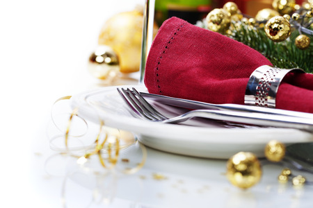 gold table cloth: Christmas table place setting with christmas decorations