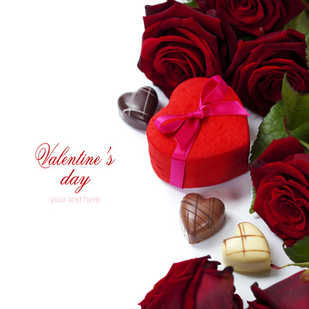 St. Valentines Day roses and chocolate over white (with easy removable text) photo