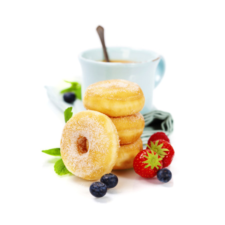 sugary: Coffee break with fresh berries and sugary donuts over white background