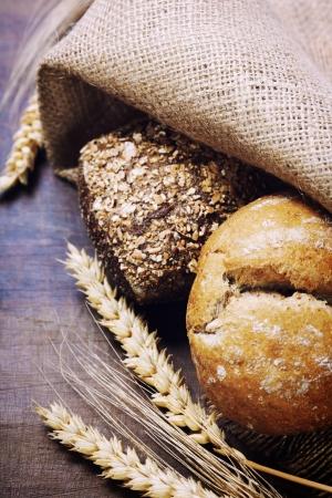 freshly: Freshly baked  bread on wooden table Stock Photo