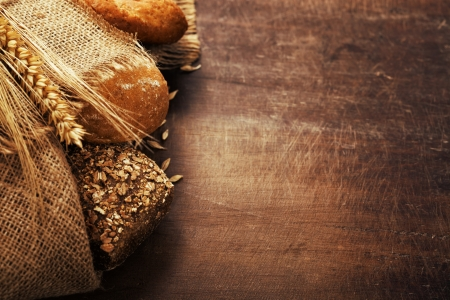 whole wheat bread: Freshly baked  bread on wooden table Stock Photo