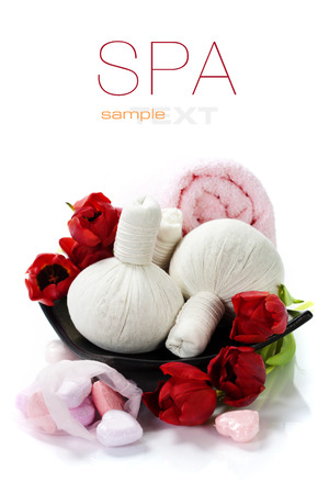 Bath and spa Valentine theme with thai herbal compress stamps, towel, bath soaps and tulips (with easy removable text) photo