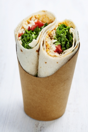 tortilla wraps with chicken and fresh vegetables isolated on white photo