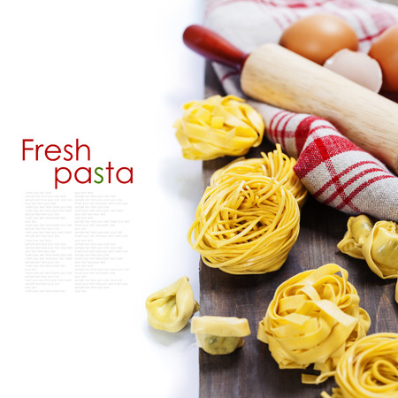 rollingpin: Making homemade pasta on wooden table (with easy removable sample text)