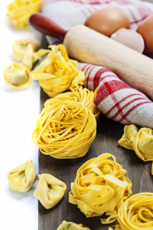 rollingpin: Making homemade pasta on wooden table Stock Photo