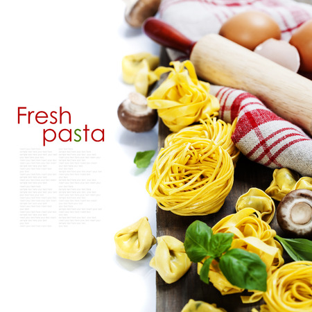 rollingpin: Fresh pasta and italian ingredients on wooden table (with easy removable sample text) Stock Photo