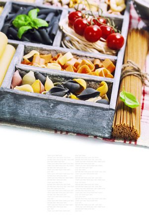 settling: Assorted pastas in wooden box Stock Photo