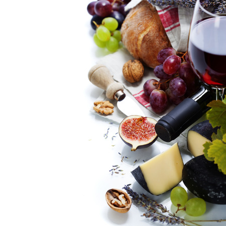 Wine, grape and cheese over white photo