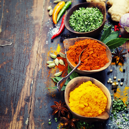 Spices and herbs over Wood. Food and cuisine ingredients. photo