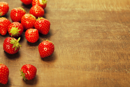 Fresh strawberries on wooden background photo