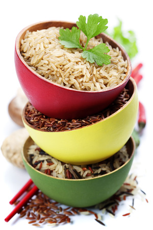 basmati: Three bowls with different types of rice on white background