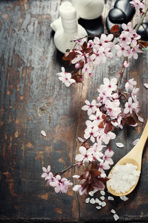 dark cherry: Spa setting with cherry blossoms  over wooden