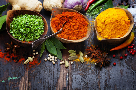 curry: Spices and herbs over Wood. Food and cuisine ingredients.