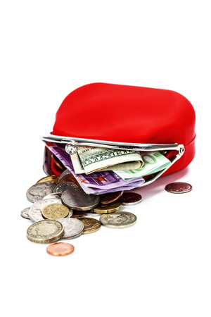 economise: Red purse with money on white background