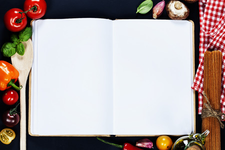 recipe book: Fresh Organic Vegetables and Spices on a Wooden Background and Paper for Notes. Open Notebook and Fresh Vegetables Background. Italian ingredients