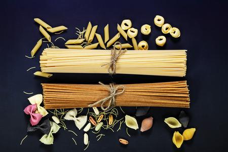 pantry:  italian pasta, different varieties on dark background