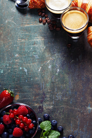 styled interior: Breakfast with coffee, croissants and berries Stock Photo
