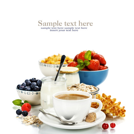 Healthy breakfast - yogurt, coffee, muesli and berries - Health and Diet concept