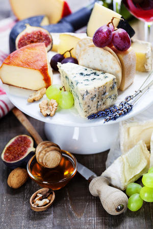 Wine and cheese plate - close up image photo