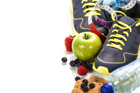 Different tools for sport and healthy food for diet on white background - sport, health and diet concept Imagens
