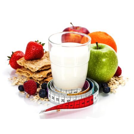 kefir: Glass of milk or  kefir, fruits, crispbreads, berries and measuring tape isolated on white