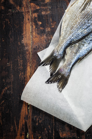 fresh dorado fish and vegetables on wooden board - food and drink photo