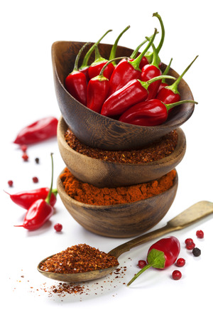 chili pepper: Red Hot Chili Peppers with herbs and spices over white background - cooking or spicy food concept