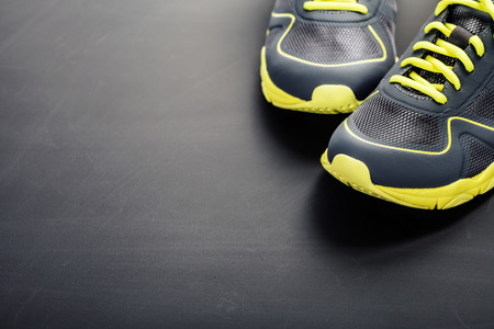 grey background: Sport shoes on grey background Stock Photo