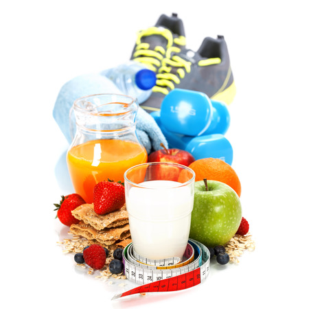 Different tools for sport and diet food  on white background - sport, health and diet concept