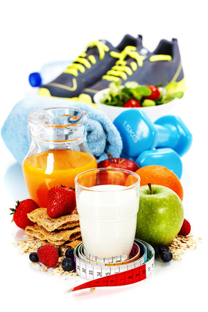 Different tools for sport and diet food  on white background - sport, health and diet concept photo