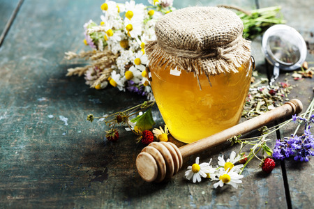 remedy: Honey and Herbal tea on wooden background - summer, health and organic food concept