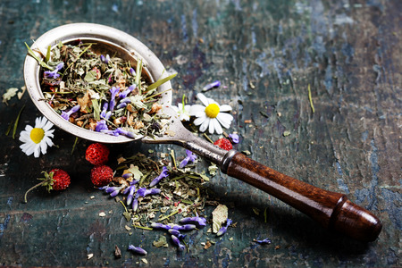 loose: Herbal tea with wild flowers and berry on wooden background - bio food, health and diet concept