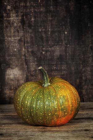 harvest basket:  Pumpkin  on old wooden table