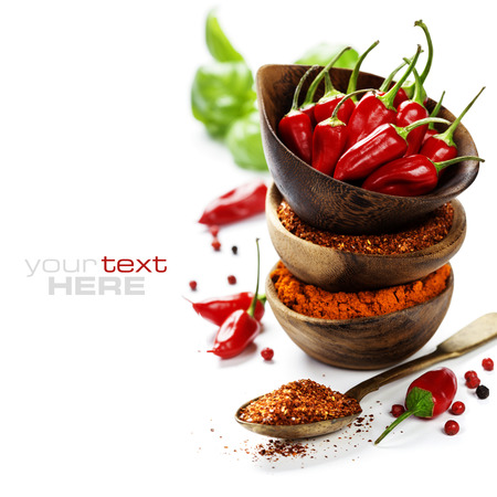 spice: Red Hot Chili Peppers with herbs and spices over white background - cooking or spicy food concept