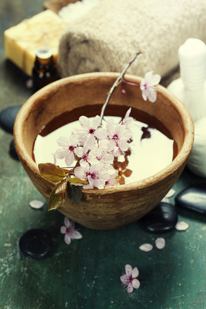 dark cherry: Spa setting on old  wooden board