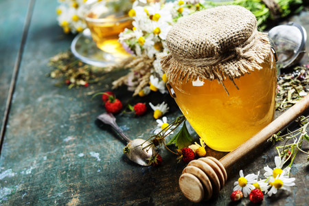 blossom honey: Honey and Herbal tea on wooden background - summer, health and organic food concept