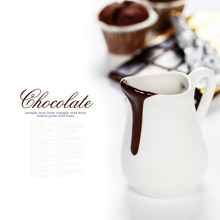 melted chocolate: Delicious rich and thick chocolate sauce in a jug and assorted chocolates - food and drink