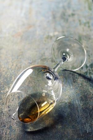 Glass of white wine on dark background photo