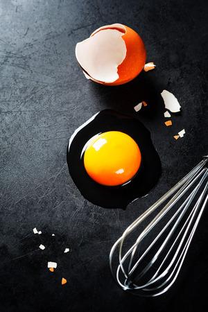 single whip: Raw egg on dark background Stock Photo
