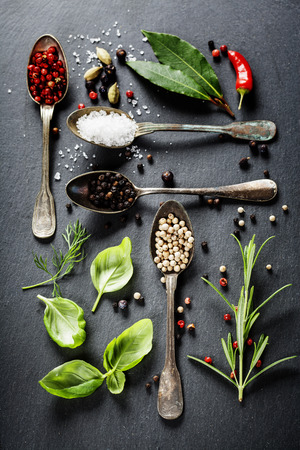 Herbs and spices selection - herbs and spices, old metal spoons and slate background - cooking, healthy eating Foto de archivo