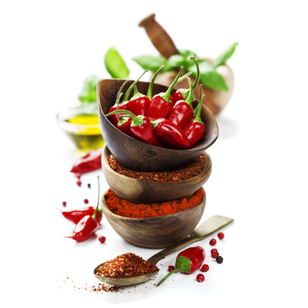 Red Hot Chili Peppers with herbs and spices over white background  Stock Photo