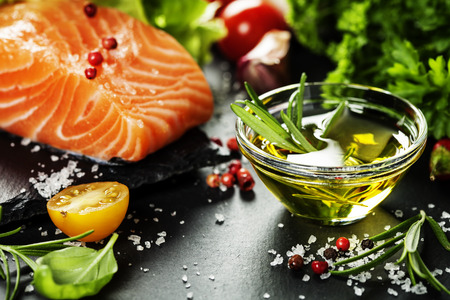 diet dinner: Delicious  portion of fresh salmon fillet  with aromatic herbs, spices and vegetables - healthy food, diet or cooking concept Stock Photo