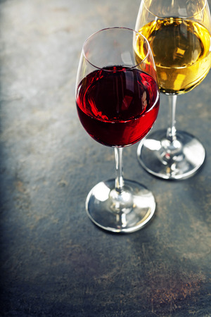 Food background with Glasses of white and red wine