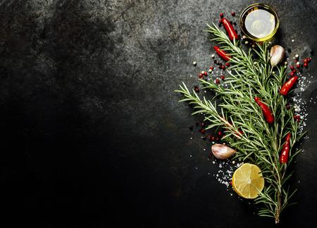 garlic: Bunch of spices on dark vintage background.  Stock Photo