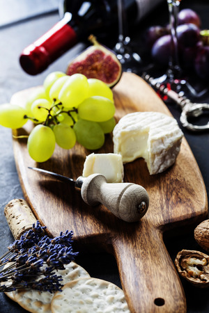 Food background with Wine, cheese and Grape. photo